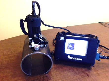 "Figure 1. Acoustocam with encoder and dual-element transducer on an 8"" pipe."