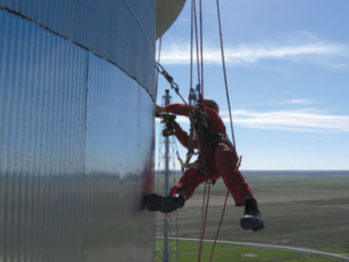Figure 1. Rope access technician performing insulation repair.