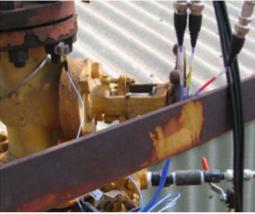 Figure 1: Compressor piping vibra- tion problem. Field measurement using triaxial accelerometer and dynamic pressure sensors