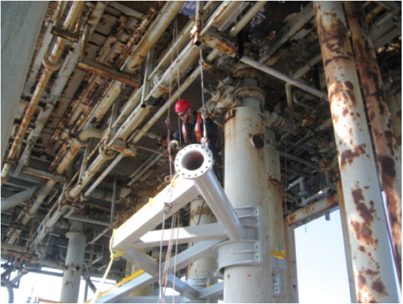 Figure 4. Rope access technician assisting with deck replacement.