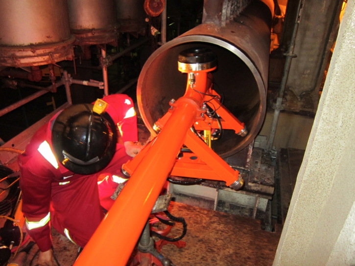 Figure 3. The snorkel system being inserted into a common header.
