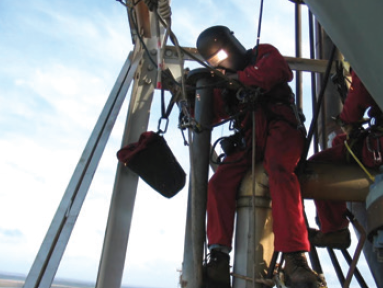 Figure 2. Rope access technician performing flange welding.