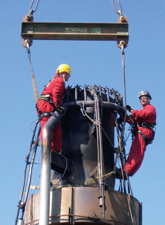 Figure 5. Rope access technicians assisting with flare tip replacement.