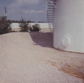 Single-wall tank in earthen berm