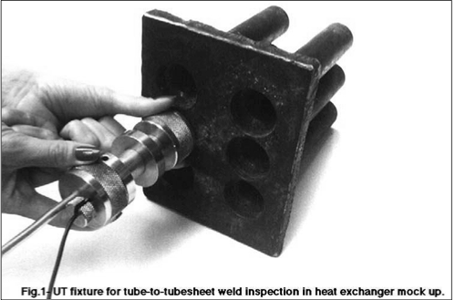 Fig.1 pictures the fixture being tested in a mockup of a portion of the exchanger tubesheet