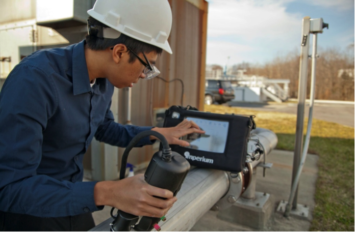 Figure 2. NDT technician performing field inspection.